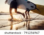 son and father surfers run in... | Shutterstock . vector #791256967