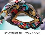Venetian Mask On A Table In...