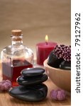 spa hot stone essential oil and candle - stock photo