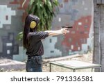 woman aiming pistol at target... | Shutterstock . vector #791336581