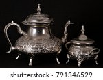 silver teapots with black