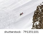 A Group Of Skiers Skiing...