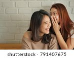 Small photo of woman gossiping, whispering, listening to positive rumor or hearsay