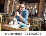 smiling modern student reading... | Shutterstock . vector #791463679