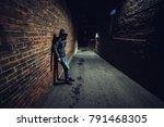 suspicious man in dark alley... | Shutterstock . vector #791468305