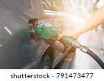 grey car at gas station being... | Shutterstock . vector #791473477