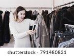 ordinary girl deciding on warm... | Shutterstock . vector #791480821