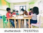 teachers and children  having... | Shutterstock . vector #791537011