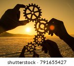 four hands collect the gear... | Shutterstock . vector #791655427