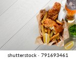 fish and chips with lemon... | Shutterstock . vector #791693461