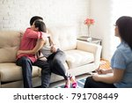 young happy couple sitting on... | Shutterstock . vector #791708449