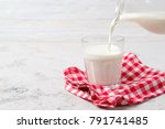 pouring fresh milk from jug... | Shutterstock . vector #791741485