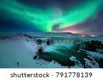 Stock photo a stunning aurora shape like phoenix bird appears above the landscape of godafoss water fall in 791778139