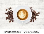 a cup of coffee and roasted... | Shutterstock . vector #791788057