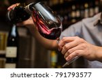 waiter pouring red wine in a... | Shutterstock . vector #791793577
