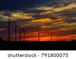 wind turbines at sunset. | Shutterstock . vector #791800075