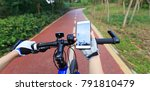 cyclist using smartphone for... | Shutterstock . vector #791810479