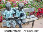 Two Kid Sculpture Reading A...