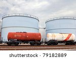 train wagons and oil and fuel storage tanks - stock photo