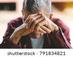 senior man covering his face... | Shutterstock . vector #791834821