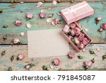 Stock photo blank paper card with little pink roses in a box on old wooden turquoise background place for text 791845087