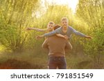 two sons and his spring in... | Shutterstock . vector #791851549