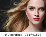 curly blonde hair woman portrait | Shutterstock . vector #791941519
