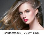 curly blonde hair woman portrait | Shutterstock . vector #791941531