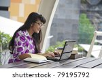 Young asian woman with glasses working outdoor - stock photo
