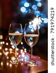 two champagne glasses on glass...   Shutterstock . vector #791974219