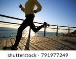 sporty female jogger morning... | Shutterstock . vector #791977249