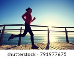 sporty female jogger morning... | Shutterstock . vector #791977675