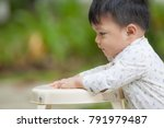 the cute boy in the garden ... | Shutterstock . vector #791979487
