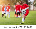 boy kicking football on the... | Shutterstock . vector #791991451