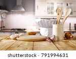 cook hat on wooden table.... | Shutterstock . vector #791994631