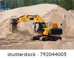 excavator digs the sand. | Shutterstock . vector #792044005