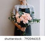 young florist woman holding... | Shutterstock . vector #792046315
