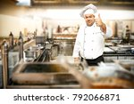 cook chef in kitchen interior.... | Shutterstock . vector #792066871