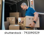 delivery man scanning cardboard ... | Shutterstock . vector #792090529