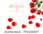 Stock photo three red roses and some red roses petals and text happy valentine s day isolated on white 792103357