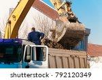 worker looks at bulldozer... | Shutterstock . vector #792120349