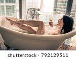 seductive woman taking relaxing ...   Shutterstock . vector #792129511