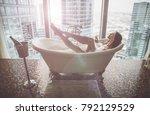 seductive woman taking relaxing ... | Shutterstock . vector #792129529
