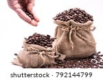 Coffee Beans On A White...
