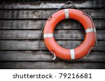 life buoy attached to a wooden...