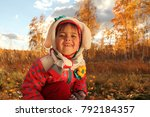the girl in the autumn forest | Shutterstock . vector #792184357