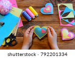 child holds a felt valentine in ...