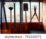 garden tools hanging up in a... | Shutterstock . vector #792210271