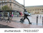 Small photo of SCOTLAND, DUNDEE, HIGH STREET - OCTOBER 16, 2014: Desperate Dan and Minnie the Minx Statue in the City Centre of Dundee in Scotland