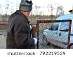 welder makes a fence in the... | Shutterstock . vector #792219529